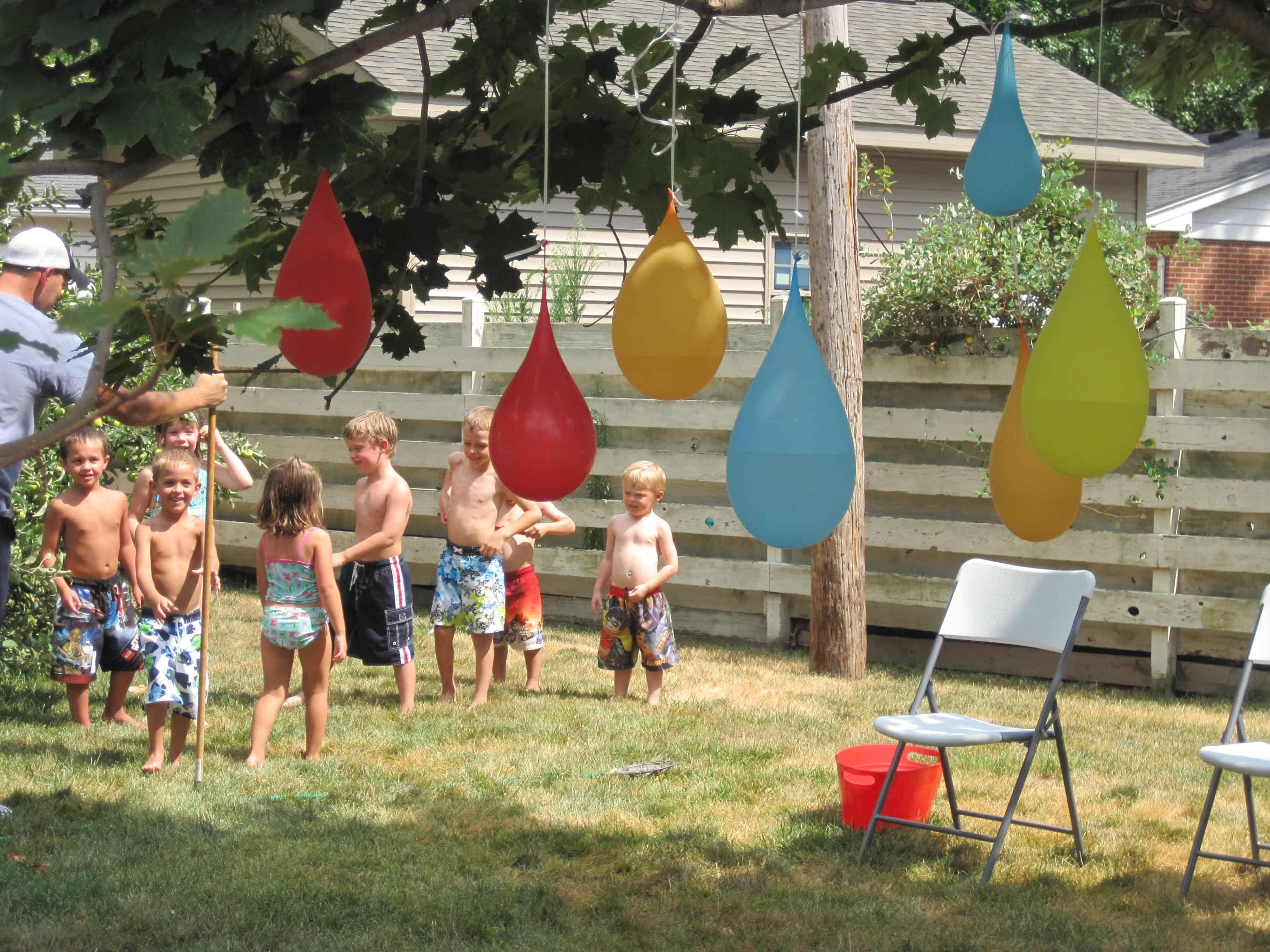 Backyard Water Party With Water Balloon Pinatas | Milk ...